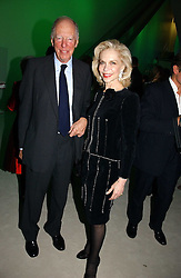 LORD ROTHSCHILD and LYNNE WYATT at an exhibition of David Hockney portraits at the National Portrait Gallery sponsored by Burberry on 11th October 2006.<br />