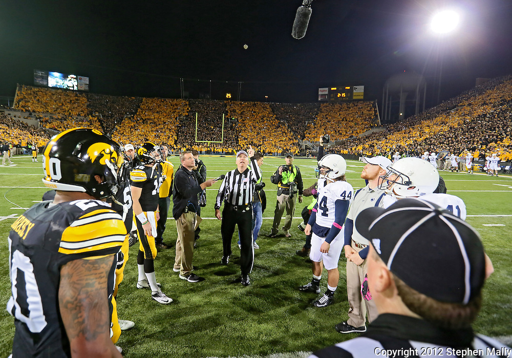October 20 2012: Referee Dan Capron performs the coin toss before the start of the NCAA football game between the Penn State Nittany Lions and the Iowa Hawkeyes at Kinnick Stadium in Iowa City, Iowa on Saturday October 20, 2012. Penn State defeated Iowa 38-14.