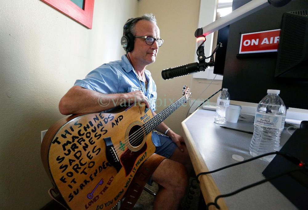18 August. New Orleans, Louisiana.<br /> Radio NOLA HIV 102.3 LPFM.<br /> Musician Paul Sanchez on air.<br /> Photo©; Charlie Varley/varleypix.com