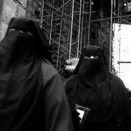 Egypt. Cairo : market in AL Mu'izz LI DIN Allah street under THE GHURIYA, Al Ghuri mosque and khanqa complex  . The Funerary Complex of al-Ghuri, Madrasa, Mosque, Khanqah, Mausoleum and Sabil-Kuttab. Islamic Cairo  Cairo -  NM 189 , 65 66 67