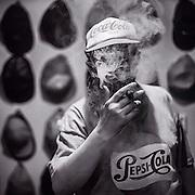 Lothar smoking a cigar. #lothar #shadow #light #latergram #germany #oberursel #portrait #whateverthatmeans #man #pepsi  #cola #cap #thelostfiles