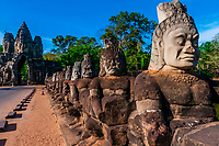 South Gate causeway bridge lined with statues of various gods, Angkor Thom (Angkor Wat complex), Cambodia.