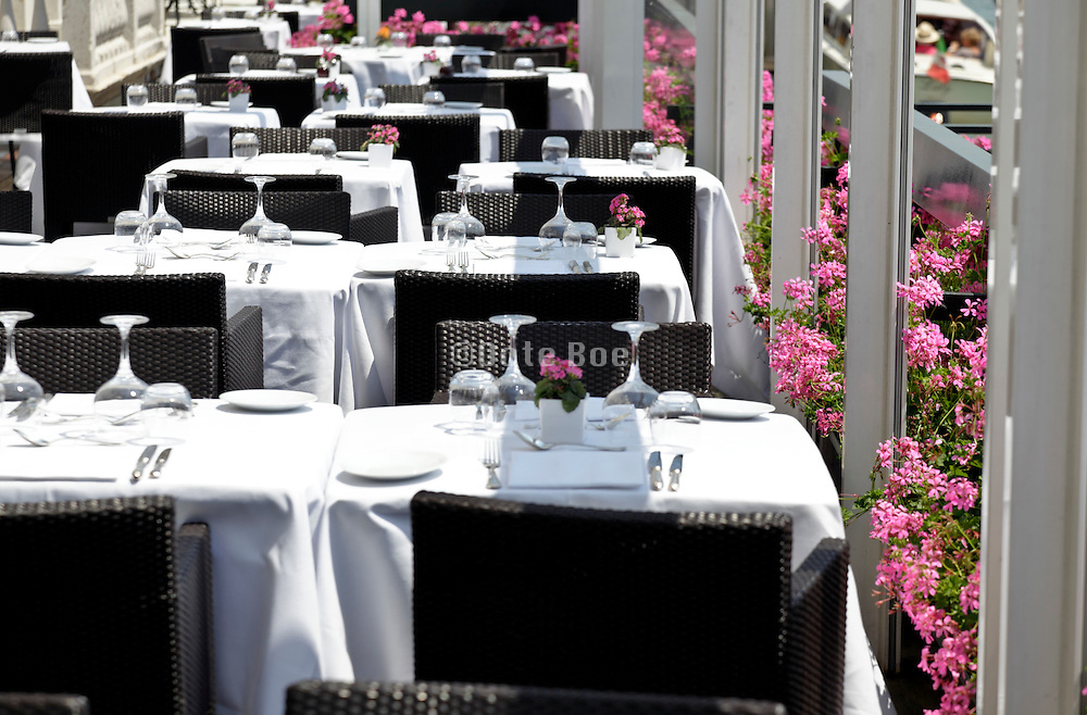 set dining tables outdoors terrace at an upscale restaurant Venice Italy