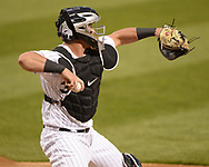 CHICAGO - APRIL 29:  James McCann #33 of the Chicago White Sox throws the baseball toward second base against the Baltimore Orioles on April 29, 2019 at Guaranteed Rate Field in Chicago, Illinois.  (Photo by Ron Vesely)  Subject:   James McCann