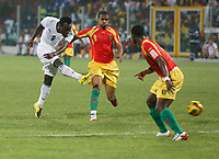 Photo: Steve Bond/Richard Lane Photography.<br />Ghana v Guinea. Africa Cup of Nations. 20/01/2008. Michael Essien (L) shoots before Kanfory Sylla (C) can get to him