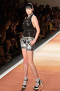 Silver-gray and black print shorts with a glittery black halter top.;