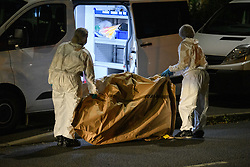 © Licensed to London News Pictures. 15/08/2021. Slough, UK. Forensic investigators place evidence, believed to be a bicycle, into a van following a double stabbing in Cippenham, Slough. Emergency services were called at approximately 17:00BST on Sunday 15/08/2021 to the Eltham Avenue area of Slough to reports that two male teenagers had been assaulted during an altercation between a number of youths. Both were taken to hospital with stab wounds. Photo credit: Peter Manning/LNP