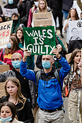"CARDIFF, WALES - 06 JUNE 2020 - Protester holds a sign up with ""Wales is guilty'' on it during black lives matter protest (Credit: John Smith / Same Old Smith Photography)"