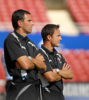 Photo: Ed Godden.<br />Swindon Town v Stockport County. Coca Cola League 2. 26/08/2006.L-R, the Swindon Management team of Gus Poyet and Dennis Wise.