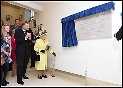 Image ©Licensed to i-Images Picture Agency. 01/12/2016. London, United Kingdom. The Queen Visits Goodenough college. <br /> <br /> Queen Elizabeth II unveils a plaque after meeting members of Goodenough College during a visit on December 1, 2016 in London, England. Goodenough College is the leading residential community for British and international postgraduate students studying in London<br /> <br /> <br /> Picture by i-Images / Pool
