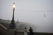 Early morning fog over the River Thames, the Embankment and Westminster Bridge from the southbank.