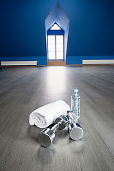 Empty fitness training room towel barbell water