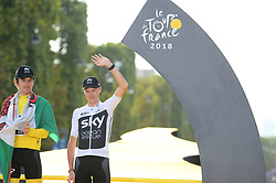 Tour de France 2018 winner Great Britain's Geraint Thomas (L), wearing the overall leader's yellow jersey, with third-placed Great Britain's Christopher Froome (R) as they celebrate on the podium after the 21st and last stage of the 105th edition of the Tour de France cycling race between Houilles and Paris Champs-Elysees, in Paris, France, on July 29, 2018. Photo by Eliot Blondet/ABACAPRESS.COM