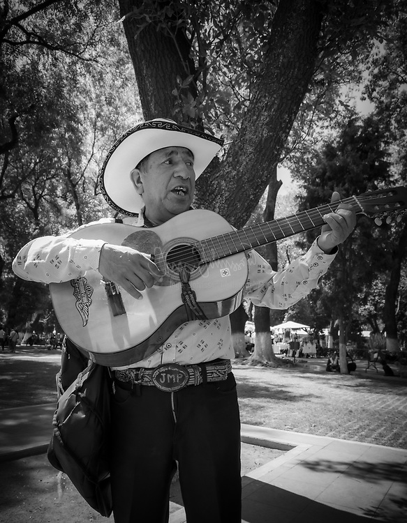 Street performer in Cholula, Mexico.<br /> ---<br /> Cholula is a city and district located in the center west of the state of Puebla, near Puebla City, in central Mexico. Cholula is best known for its Great Pyramid, with the Iglesia de Nuestra Señora de los Remedios sanctuary on top, as well as its numerous churches. The city and district are divided into two, San Pedro Cholula and San Andrés Cholula, which together are officially called the Distrito Cholula de Rivadavia. Surrounding the city proper is a number of more rural communities which belong to the municipalities of San Andrés and San Pedro. The city itself is divided into eighteen neighborhoods or barrios, each with a patron saint. This division has pre-Hispanic origins as does the division into two municipalities. The city is unified by a complicated system of shared religious responsibilities, called cargas, which function mostly to support a very busy calendar of saints' days and other festivals which occur in one part or another almost all year round. The most important of these festivals is that dedicated to the Virgin of the Remedies, the patron of the city in its entirety, which occurs at the beginning of September.