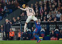 Football - 2018 / 2019 Premier League - Crystal Palace vs. Manchester United<br /> <br /> David De Gea (Manchester United) rises above Michy Batshusayi (Crystal Palace) to head clear at Selhurst Park.<br /> <br /> COLORSPORT/DANIEL BEARHAM