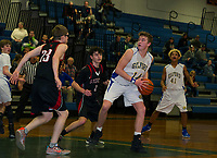 Gilford's Greg Madore looks for a pass against Stevens during NHIAA Division III first round tournament action on Thursday evening.  (Karen Bobotas/for the Laconia Daily Sun)