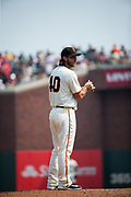 San Francisco Giants starting pitcher Madison Bumgarner (40) wipes the ball on the mound while struggling against the St. Louis Cardinals at AT&T Park in San Francisco, California, on September 3, 2017. (Stan Olszewski/Special to S.F. Examiner)