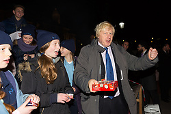 © Licensed to London News Pictures. 16/12/2014. London, UK. Boris Johnson gives out sweets to children at the lighting of a Menorah, Chanukah Ceremony in Trafalgar Square, London to celebrate Chanukah (Hanukkah), the eight-day Jewish Festival of Lights. Photo credit : Vickie Flores/LNP