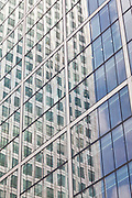One Canada Tower at Canary Wharf reflected in the glass façade of 8 Canada square. <br /> <br /> Architect: Cesar Pelli