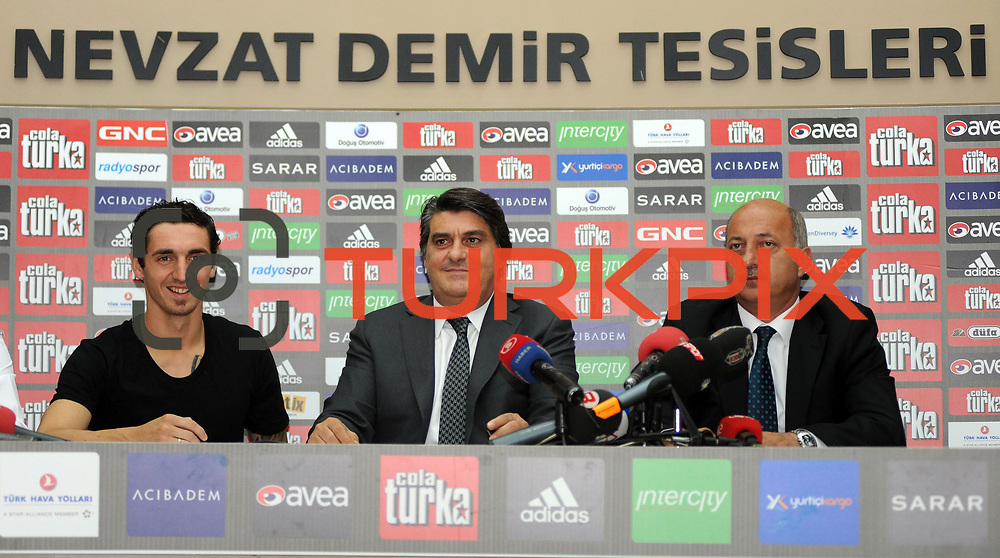 Turkish soccer team Besiktas's new player German Roberto HILBERT (L) poses for media with his new jersey after the signing ceremony in Istanbul, Turkey on 22 June 2010. Besiktas signed a contract with Roberto HILBERT for three years. Photo by TURKPIX