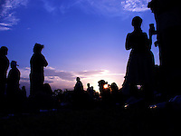 Scenes from the crowd at sunset during the Isle of Wight Rock Festival