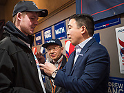 12 DECEMBER 2019 - DES MOINES, IOWA: ANDREW YANG signs the tee shirt of a supporter during the opening of his campaign office in Ames, IA. Yang, an entrepreneur, is running for the Democratic nomination for the US Presidency in 2020. He brought bus tour to Ames, IA, Thursday. Iowa hosts the the first election event of the presidential election cycle. The Iowa Caucuses will be on Feb. 3, 2020.          PHOTO BY JACK KURTZ