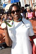 Medaillewinnaars van de Olympische Zomerspelen 2016 vertrekken per fiets van het Binnenhof voor een ontvangst op Paleis Noordeinde. <br /> <br /> op de foto:  Anicka van Emden, brons bij judo in de categorie tot 63 kilogram.