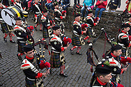 Members of the Atholl Highlanders, Europe's only private army, marching during Pipefest Stirling, an event staged at Stirling Castle to coincide with the 700th anniversary of the Battle of Bannockburn. The event was attended by 1600 pipers, Highland dancers and other musicians and formed a procession through the city's streets. The Battle of Bannockburn took place in 1314 and resulted in the defeat of Edward II's English army by the Scots under Bruce.