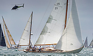 The 1934 yacht Stormy Weather racing with the fleet at the start of the 90th anniversary Rolex Fastnet Race on the Solent. A record fleet of 370 yachts will compete to win the Fastnet Challenge Cup.<br /> The 600 nautical mile race starts in Cowes, Isle of Wight, heading to the Fastnet Rock off the south west coast of Ireland and finishes in Plymouth.<br /> It is the world's biggest offshore race with 75% amateur sailors and professional yachtsmen competing against each other. <br /> Picture date Sunday 16th August, 2015.<br /> Picture by Christopher Ison. Contact +447544 044177 chris@christopherison.com