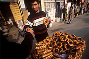 Street vendor sells hard seeded biscuits from a wheeled cart on the street in Istanbul, Turkey. (Supporting image from the project Hungry Planet: What the World Eats)