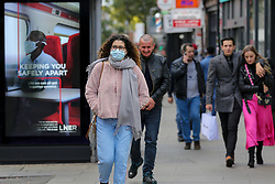 © Licensed to London News Pictures. 11/10/2020. London, UK. Shoppers in Wood Green, north London as another national coronavirus lockdown looms. <br /> SADIQ KHAN, Mayor of London has warned that a London lockdown cannot be ruled out as coronavirus cases in the capital soar. In a statement to MPs on Monday, 12 Oct 2020, Prime Minister Boris Johnson is expected to announce tougher local restrictions, outlining plans for a three-tier system, where each region in England is placed into a tier based on the severity of cases in the area. Photo credit: Dinendra Haria/LNP
