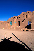 Morning light on the 3-story adobe North House (World Heritage Site), Taos Pueblo, New Mexico