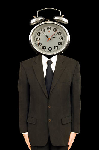 businessman with alarm clock as a head, clock watcher, time keeper,<br />