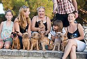 Owners posing with their Brussels Griffon after a dog exhibition