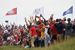 Spectators cheer on the players on the 16th green during day three of the 43rd Ryder Cup at Whistling Straits, Wisconsin. Picture date: Sunday September 26, 2021.