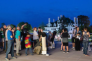 Middletown, New York - People enjoy an astronomy program on viewing constellations and planets on the Green Patio of the Rowley Center for Science and Engineering on the Middletown campus on May 12, 2015. The program was run by SUNY Orange adjunct assistant professor Tom Blon and sponsored by SUNY Orange Cultural Affairs.