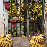 Banana vendor at a morning vegetable market in Ho Chi Minh City, Vietnam.
