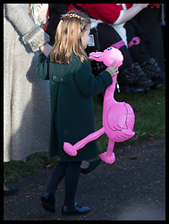 December 25, 2019, Sandringham, United Kingdom: Image licensed to i-Images Picture Agency. 25/12/2019. Sandringham, United Kingdom. Princess Charlotte carries a inflatable flamingo given to her by a well wisher as she leaves the Christmas Day church service at Sandringham in Norfolk, United Kingdom. (Credit Image: © Stephen Lock/i-Images via ZUMA Press)