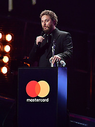 Duncan Jones accepts an award on behalf of his dad David Bowie on stage at the Brit Awards at the O2 Arena, London.