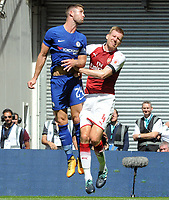 Football - 2017 Community Shield - Chelsea vs. Arsenal<br /> <br /> Per Mertesacker of Arsenal clashes heads with Gary Cahill of chelsea and as a result had to be substituted with a cut head  at Wembley.<br /> <br /> COLORSPORT/ANDREW COWIE