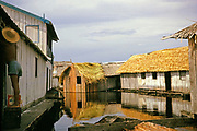 Informal housing wooden shacks built on timber logs known as the Floating City, Manaus, Brazil 1962 removed as part of slum clearance policy in late 1960s