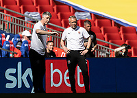 Blackpool's assistant head coach Mike Garrity converses with head coach  Neil Critchley <br /> <br /> Photographer Andrew Kearns/CameraSport<br /> <br /> The EFL Sky Bet League One Play-Off Final - Blackpool v Lincoln City - Sunday 30th May 2021 - Wembley Stadium - London<br /> <br /> World Copyright © 2021 CameraSport. All rights reserved. 43 Linden Ave. Countesthorpe. Leicester. England. LE8 5PG - Tel: +44 (0) 116 277 4147 - admin@camerasport.com - www.camerasport.com