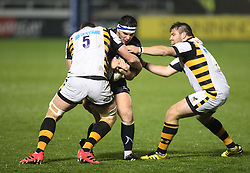 Cameron Neild of Sale Sharks (C) is tackled by Will Rowlands of Wasps (L) - Mandatory by-line: Jack Phillips/JMP - 04/11/2016 - RUGBY - AJ Bell Stadium - Sale, England - Sale Sharks v Wasps - The Anglo-Welsh Cup