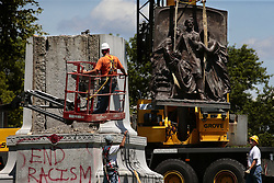 June 26, 2017 - St. Louis, MO, USA - A crane removes bronze sculpture from the Confederate monument in Forest Park on Monday, June 26, 2017. In a settlement between St. Louis and the Missouri Civil War Museum, the museum agrees to remove the massive marker and store it until a new home is found outside of St. Louis City and County. (Credit Image: © Robert Cohen/TNS via ZUMA Wire)