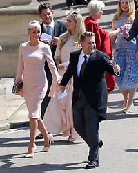 James Corden and Julia Carey arrive for the wedding of Prince Harry and Meghan Markle at Windsor Castle.