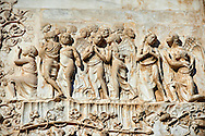 Bas-relief sculpture panel scene from the Last Judgment by Maitani around 1310 on the14th century Tuscan Gothic style facade of the Cathedral of Orvieto, Umbria, Italy .<br /> <br /> Visit our ITALY HISTORIC PLACES PHOTO COLLECTION for more   photos of Italy to download or buy as prints https://funkystock.photoshelter.com/gallery-collection/2b-Pictures-Images-of-Italy-Photos-of-Italian-Historic-Landmark-Sites/C0000qxA2zGFjd_k<br /> .<br /> <br /> Visit our MEDIEVAL PHOTO COLLECTIONS for more   photos  to download or buy as prints https://funkystock.photoshelter.com/gallery-collection/Medieval-Middle-Ages-Historic-Places-Arcaeological-Sites-Pictures-Images-of/C0000B5ZA54_WD0s