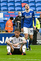 Football - 2020 / 2021 Sky Bet Championship - Cardiff City vs Rotherham United - Cardiff city Stadium<br /> <br /> Angus MacDonald Rotherham United sits on the pitch looking dejected after the final whistle. Rotherham's draw with Cardiff will result in relegation.<br /> <br /> COLORSPORT/WINSTON BYNORTH
