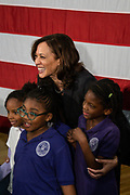 Senator Kamala Harris poses with a group of young supporters following a town hall meeting during her campaign for the Democratic presidential nomination February 15, 2019 in North Charleston, South Carolina. South Carolina is the first southern democratic primary for the presidential race.