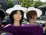 two heads with wig and hat at a flea market in Amsterdam, Waterlooplein