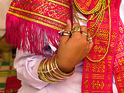 A Muslim Cham girl wearing a white dress, a handwoven red sash and bronze and copper jewellery at her Karoh (maturity) ceremony in Van Lam, Ninh Thuan province, Central Vietnam. Cham girls usually in groups of around 5, undergo a Karoh (maturity) ceremony, one of the most important ritual events of their lives and if it has not taken place, the girl cannot marry. The Cham, a Muslim community of around 39,000 people living along the coast of Central Vietnam are one of the 54 ethnic groups recognised by the Vietnamese government.